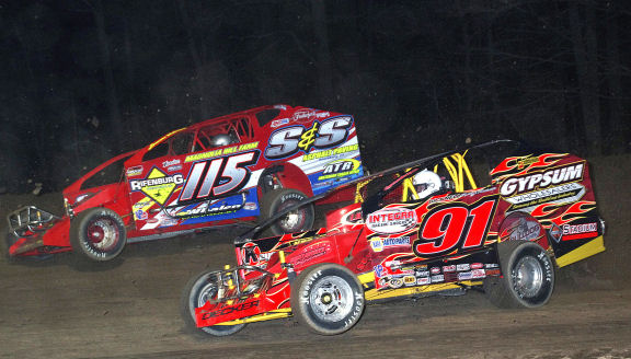 Kenny Tremont #115 battles with invader Billy Decker #91 during the 50th Annual Season Opener at Albany-Saratoga Speedway.